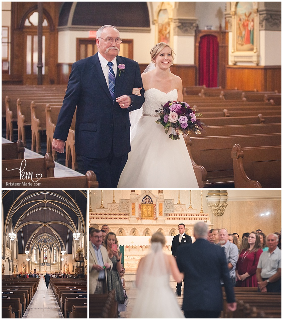 Dad walking daughter down the isle at St. John the Evangelist Catholic Church