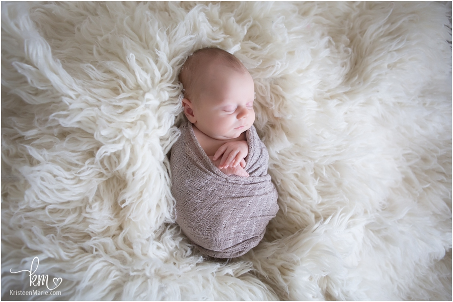 newborn baby photo with blankets