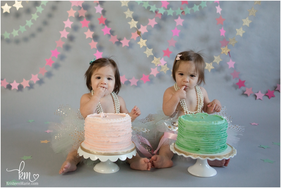 little twin girls eating birthday cake