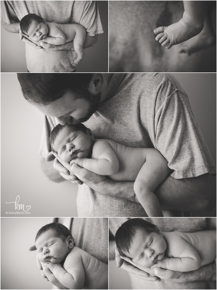 baby in dad's hand in black and white
