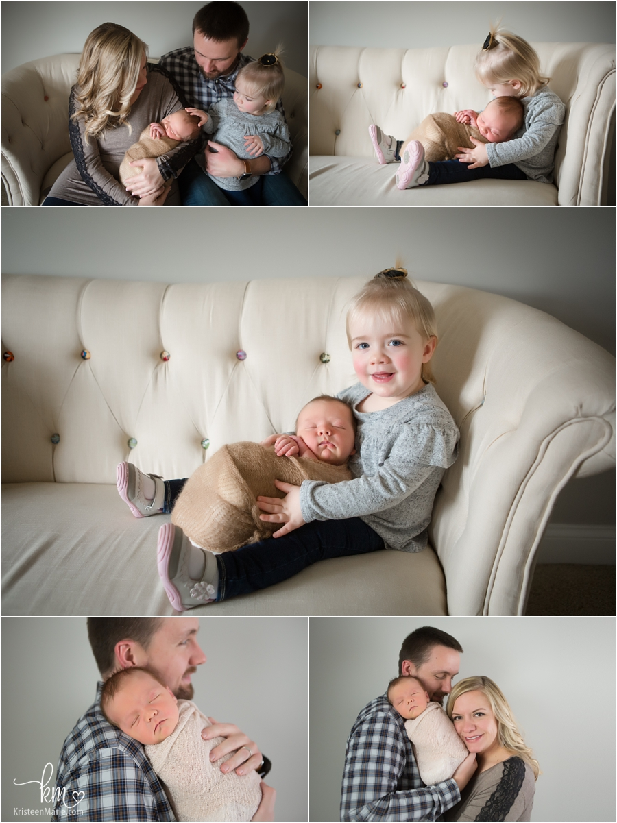 family pictures/poses with newborn baby in studio