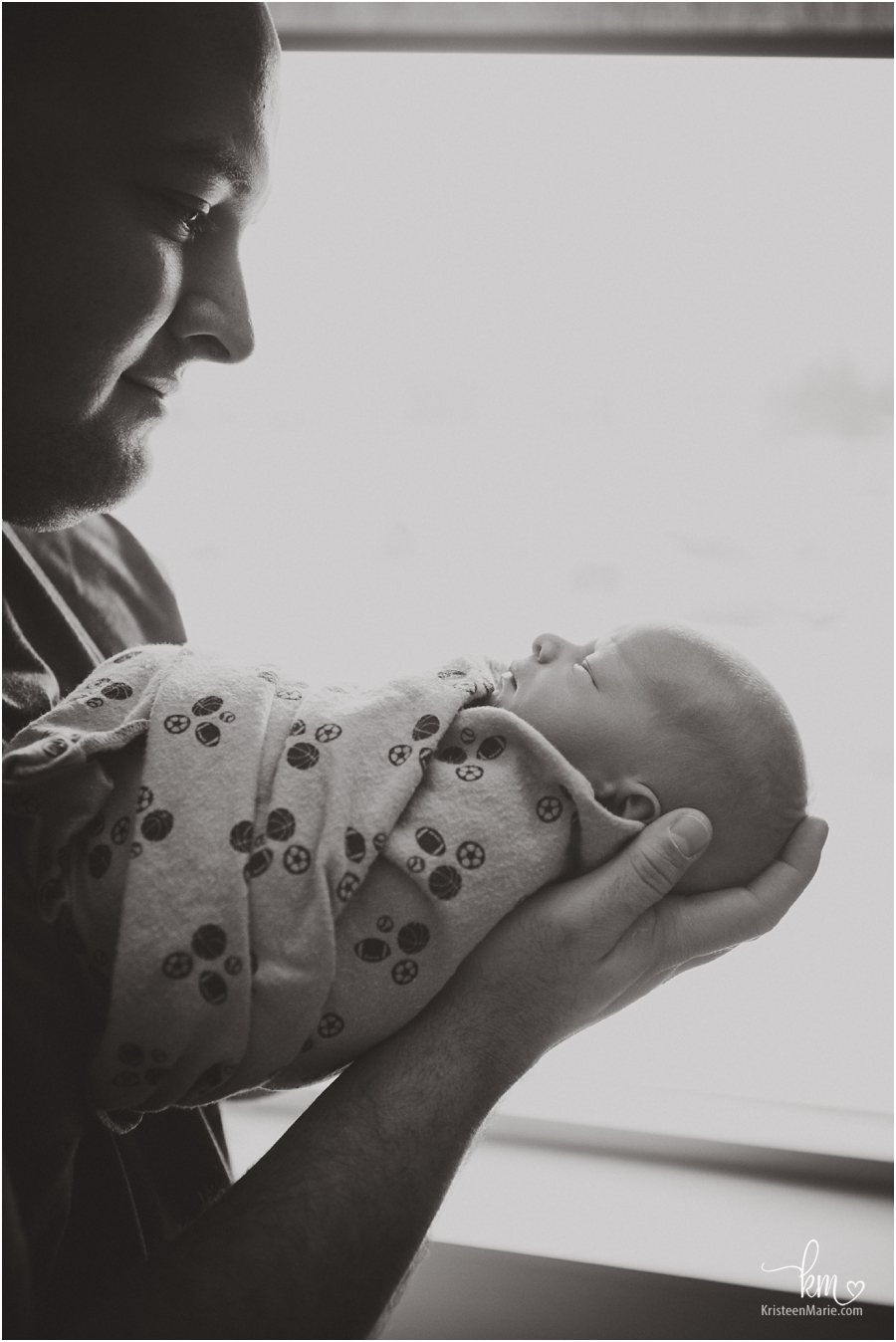 dad and newborn baby - stunning hospital shot