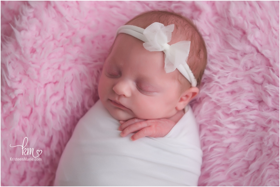 Indianapolis newborn photography by KristeenMarie - newborn in white on pink