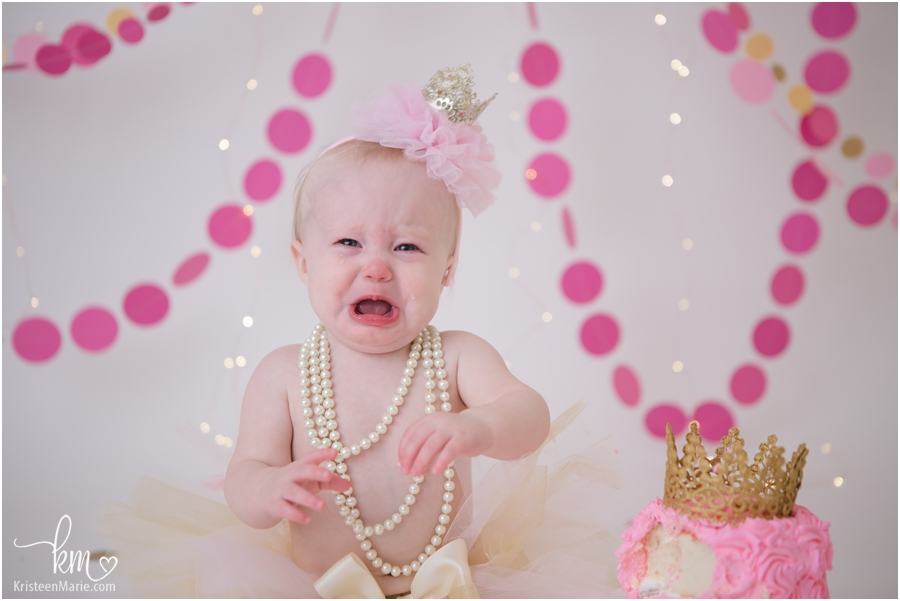 crying baby after cake smash session