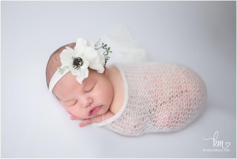 sleeping newborn baby in white - newborn photography in Carmel, IN
