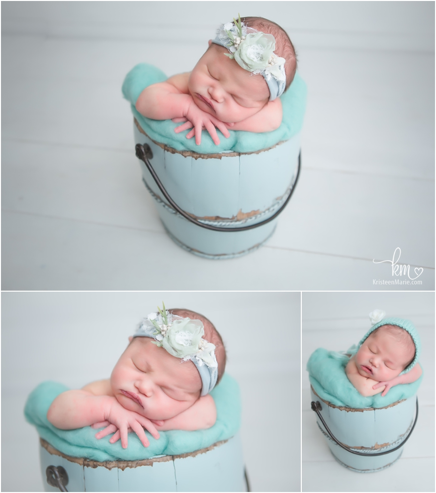 newborn baby in a bucket - teal and baby blue for a baby girl