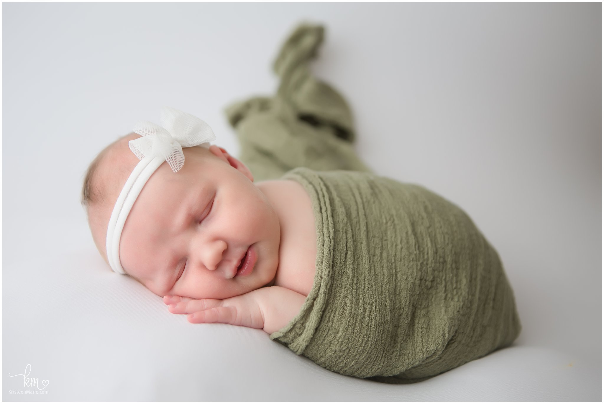 green and white newborn picture - Zionsville newborn photographer