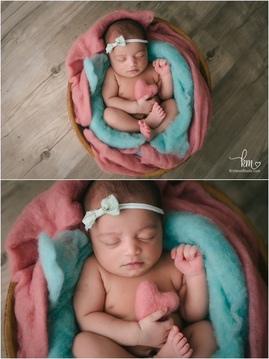 teal and pink with heart newborn picture - so cute!
