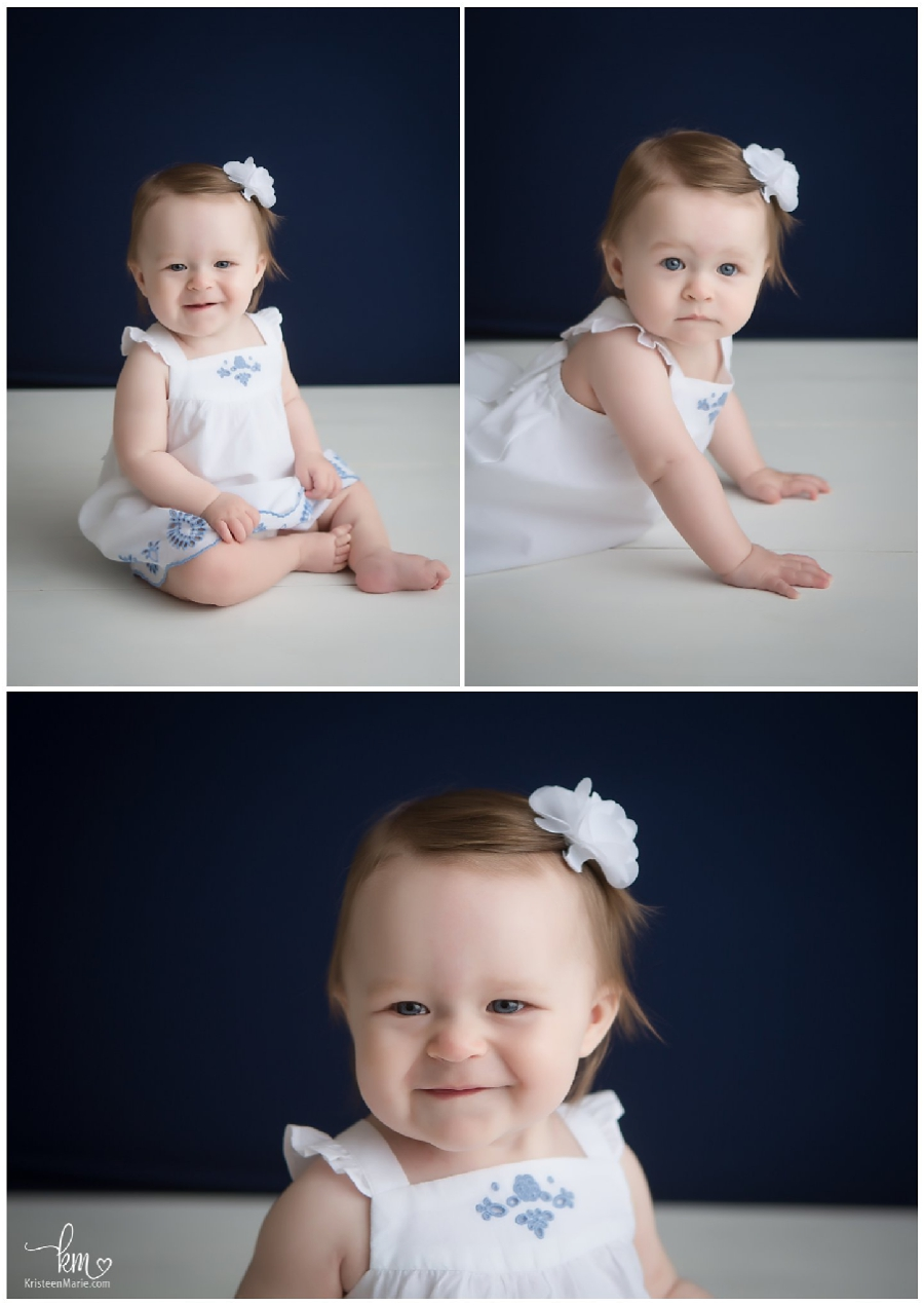 baby girl with blue eyes on blue backdrop - so sweet!
