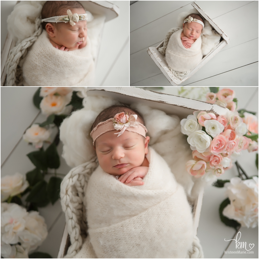 newborn baby in white with peach flowers