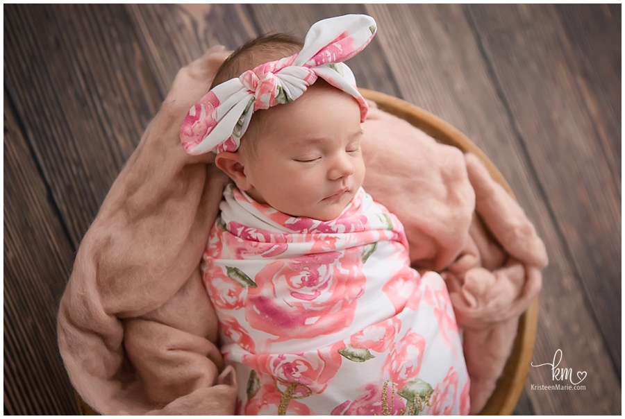 newborn baby girl with wrap and headband