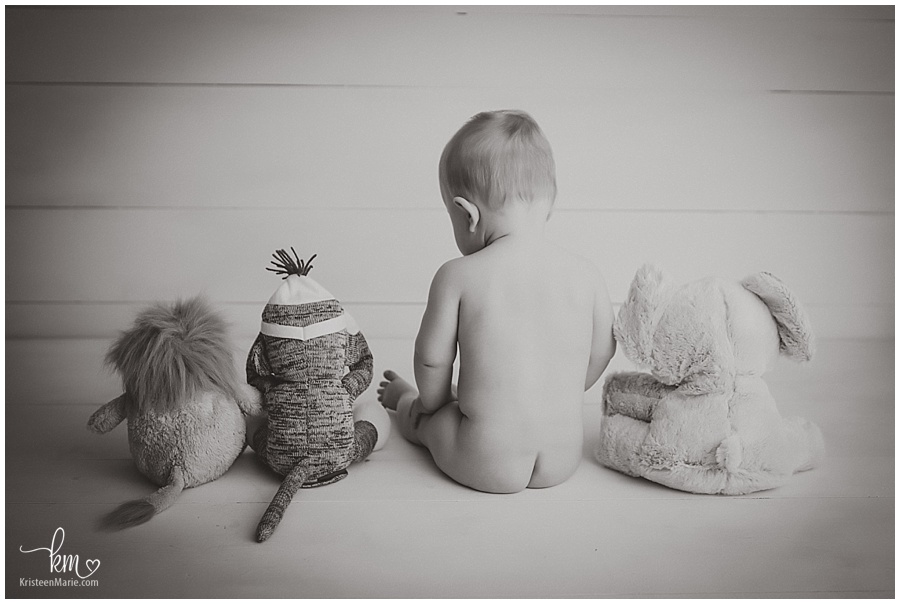 little boy with his stuffed animals photography