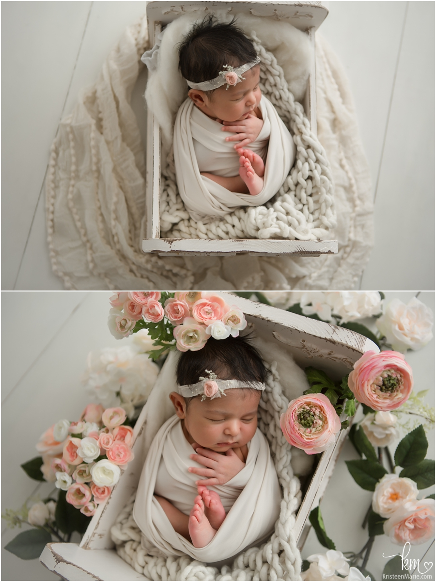 sleeping newborn girl in cream with blush flowers