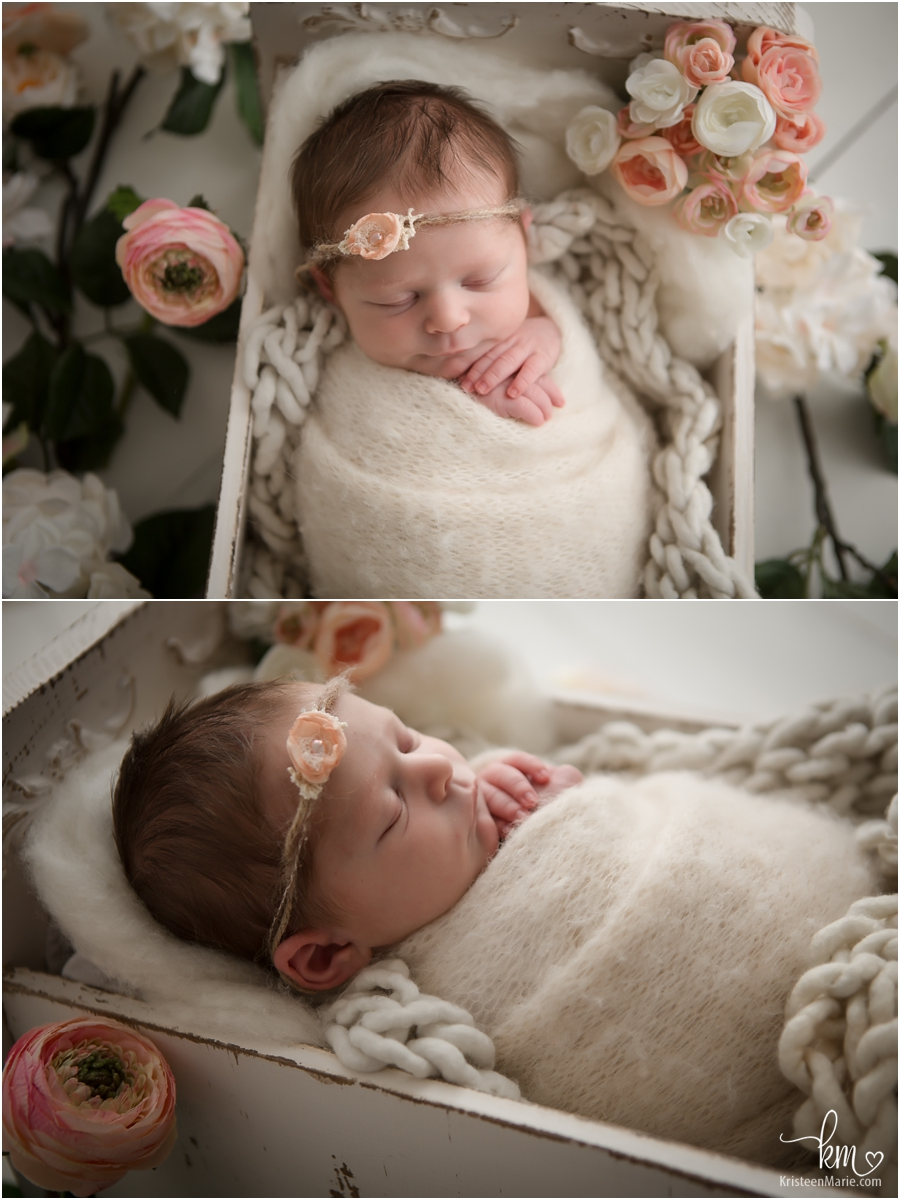 flowers and newborn baby girl