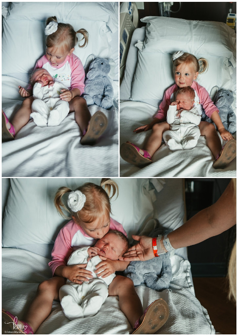 big sister loving on new baby brother in hospital