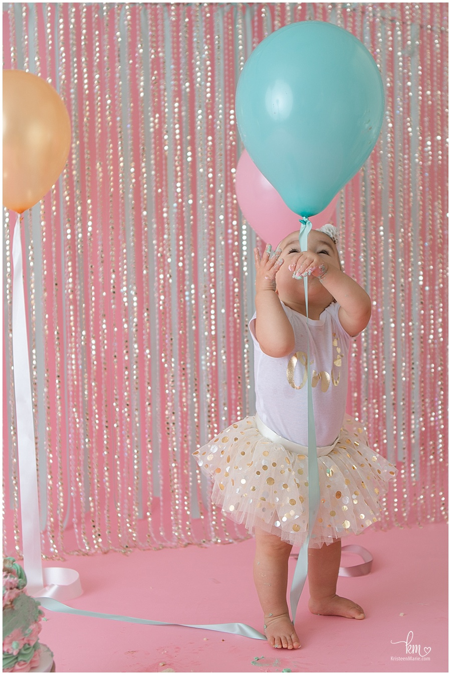 first birthday cake smash photo with balloons