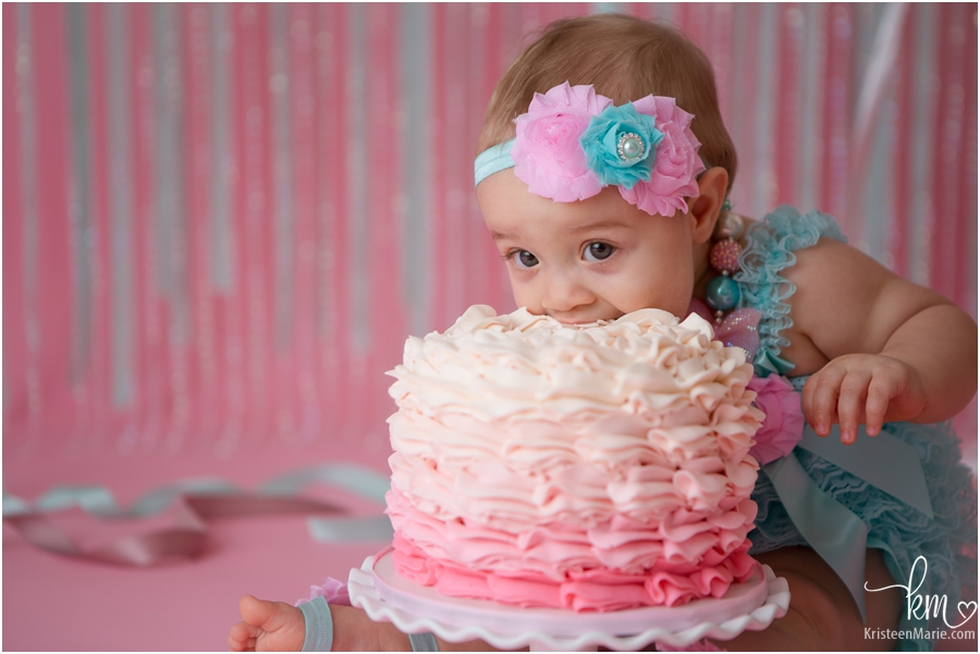 little girl eating a cake with no hands