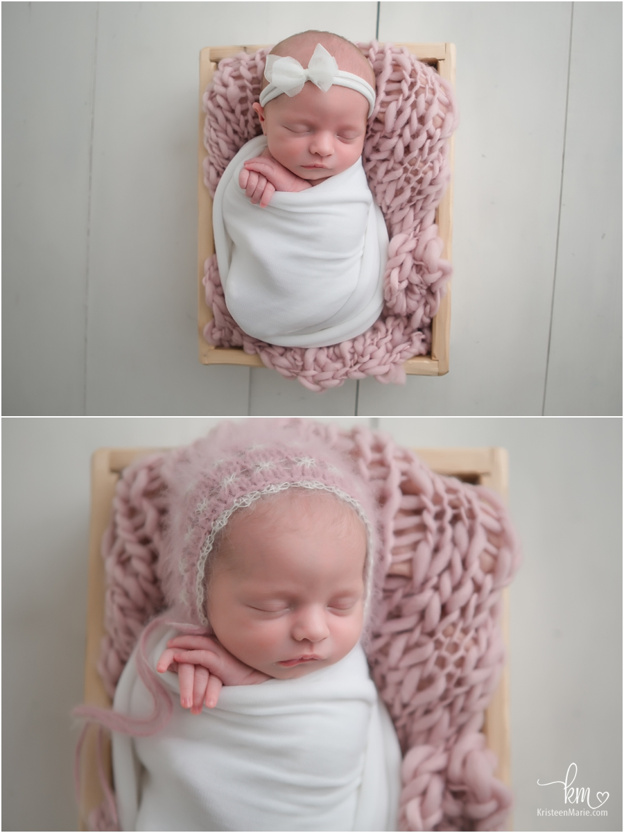 baby in a basket - soft pink and white