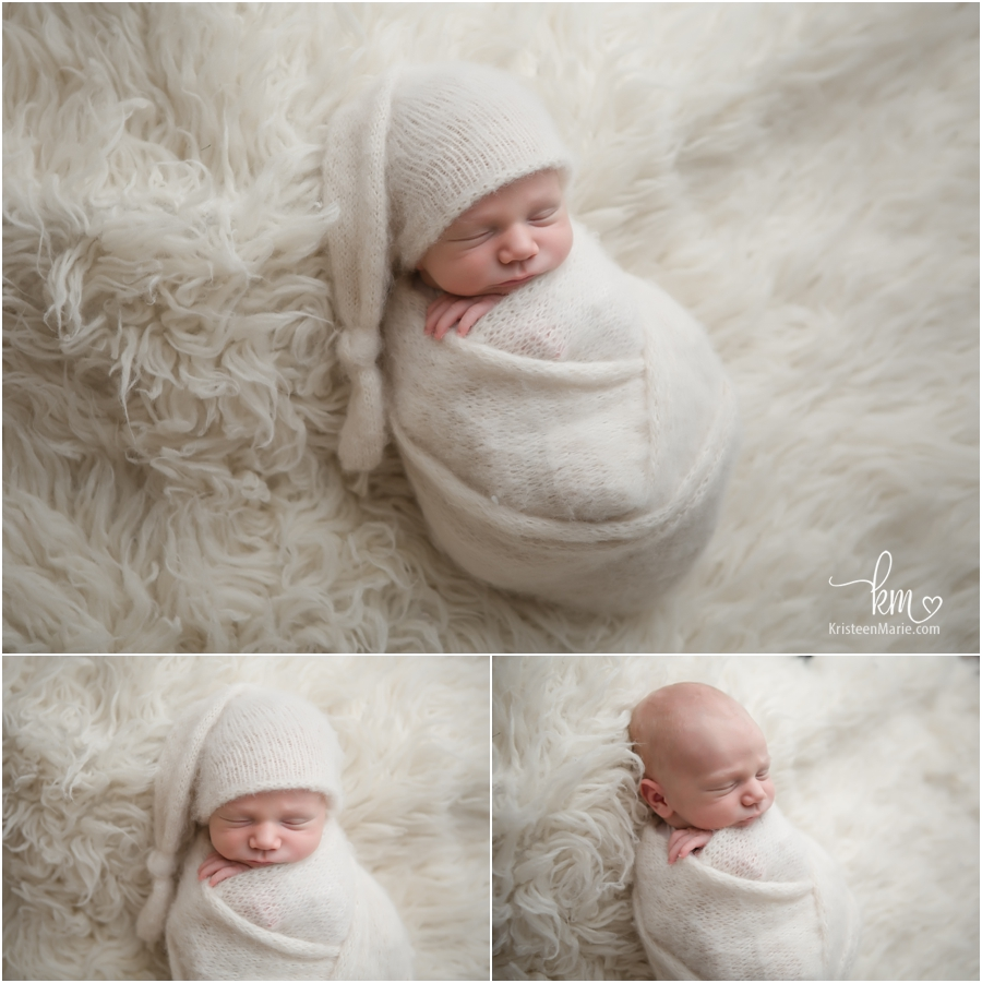 Sleeping newborn boy all bundled up