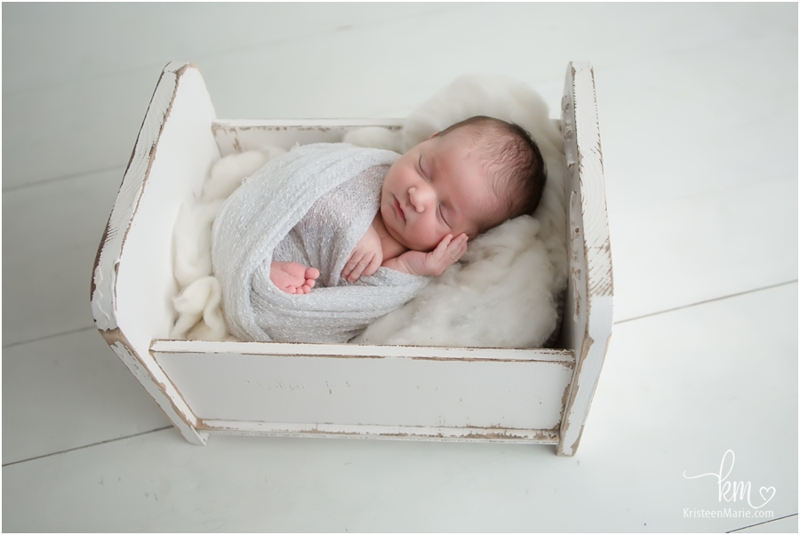 Newborn baby in crib prop - Indianapois newborn pictures