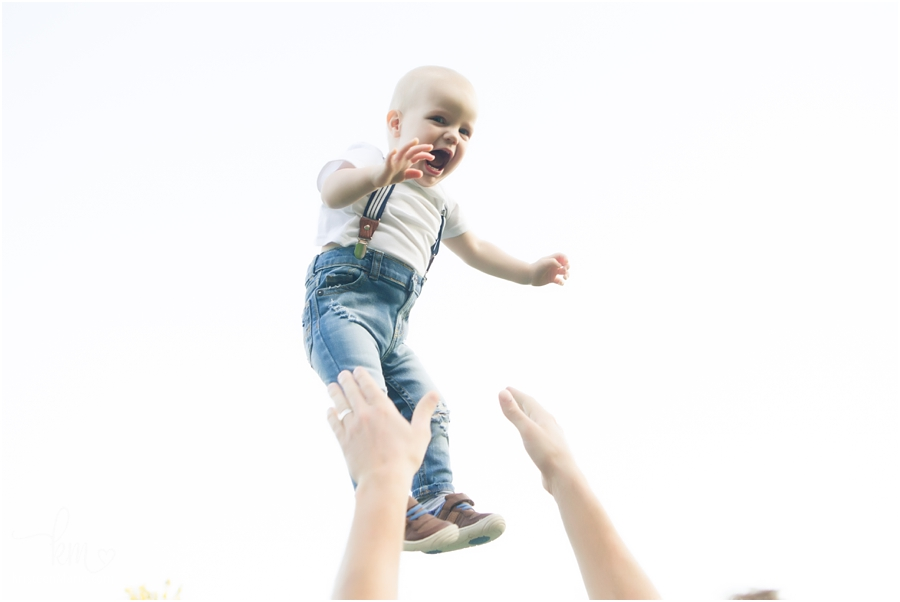 baby being thrown into the air