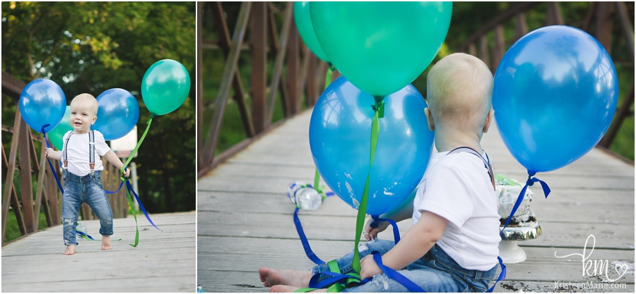 one-year-old playing with balloons