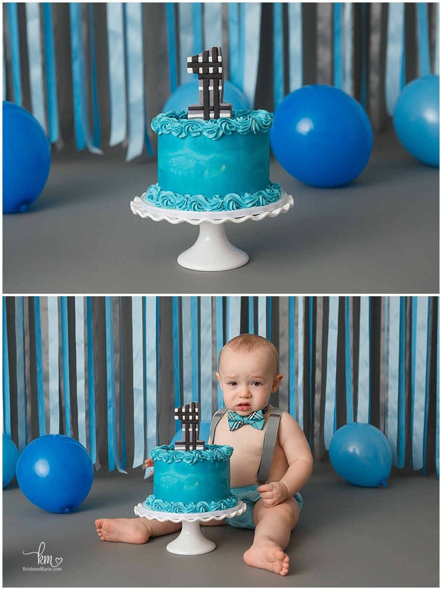 first birthday cake smash blue cake and blue and gray background