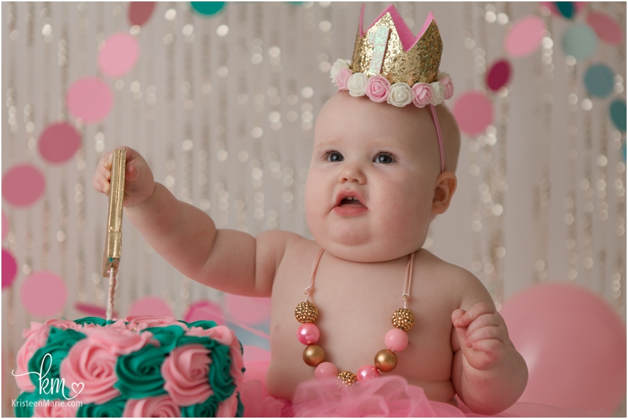 chubby baby eating birthday cake