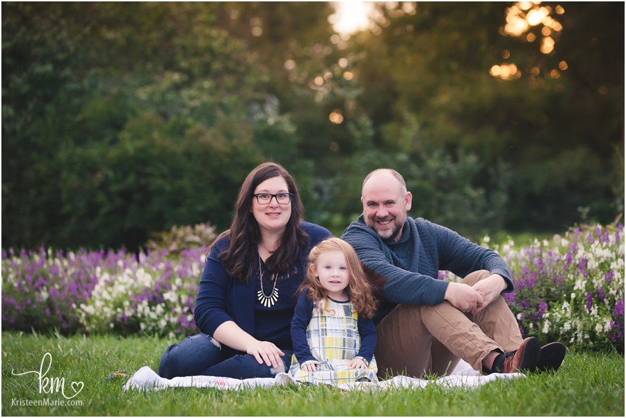adorable family in garden in Indianapolis, IN