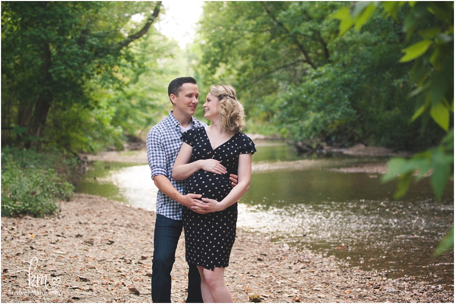 adorable expecting couple outdoors