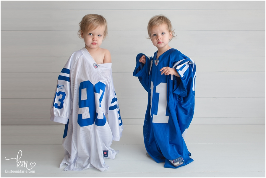 Twin girls in Dad's Colts jersies