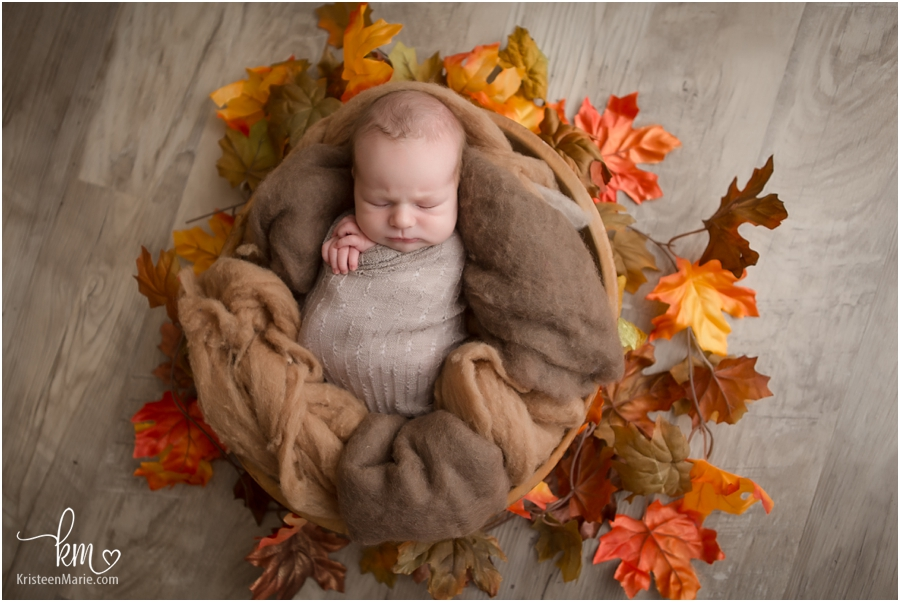 Fall themed newborn picture in photography studio in Zionsville, IN