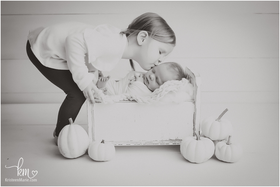 black and white image of sibling with newborn baby - Carmel Newborn photographer
