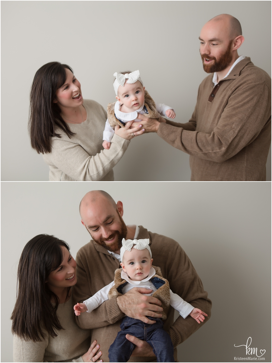 family pictures with baby and parentes in photography studio in Carmel, Indiana