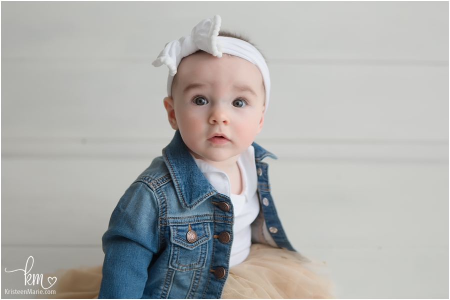 baby in a jean jacket