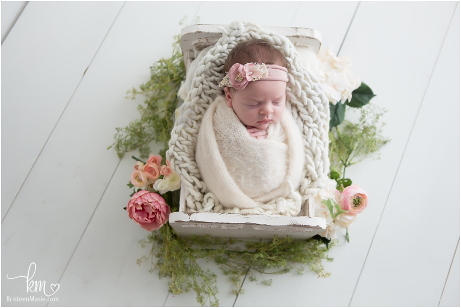 newborn baby girl with flowers