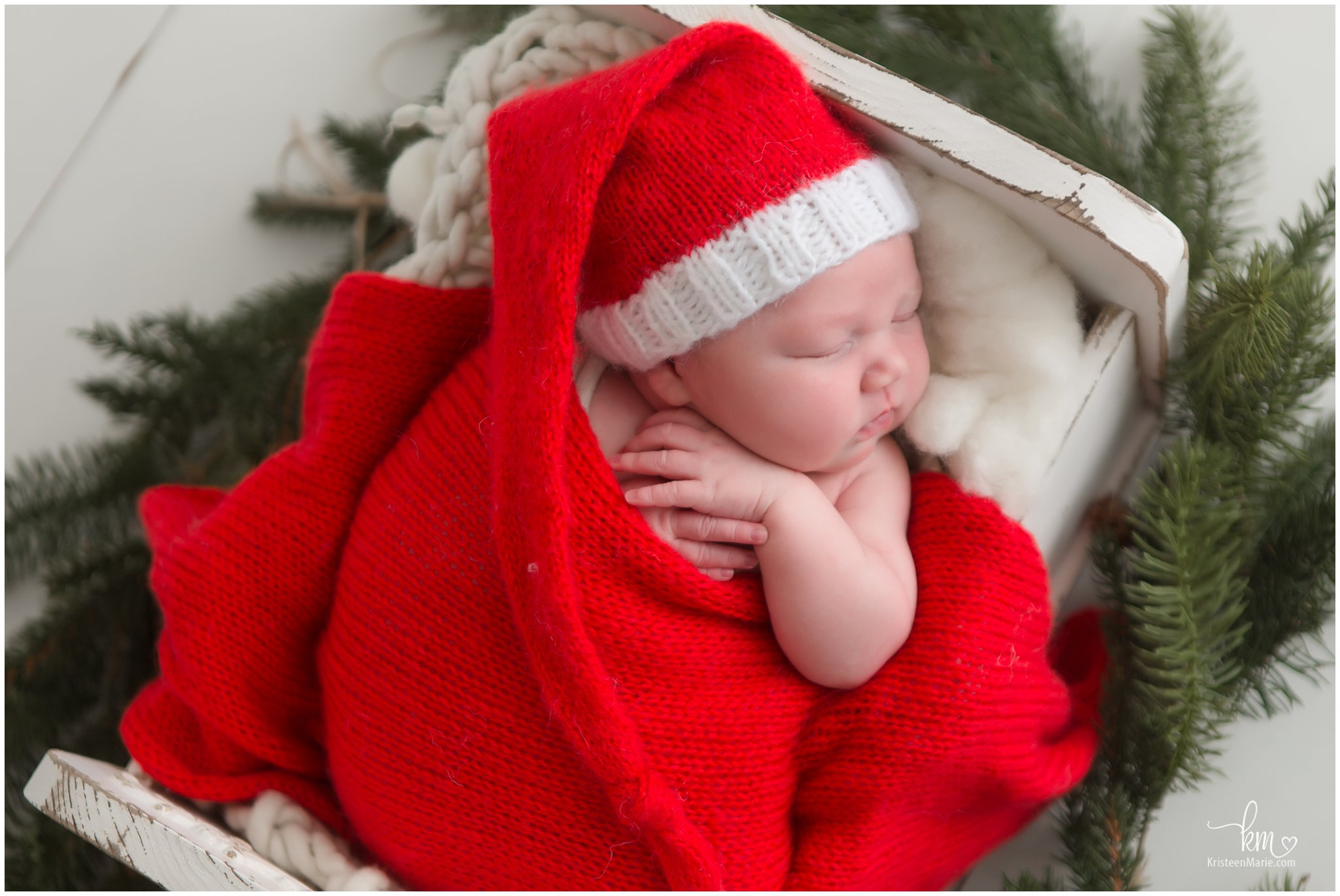 sleeping newborn baby Christmas picture - santa hat