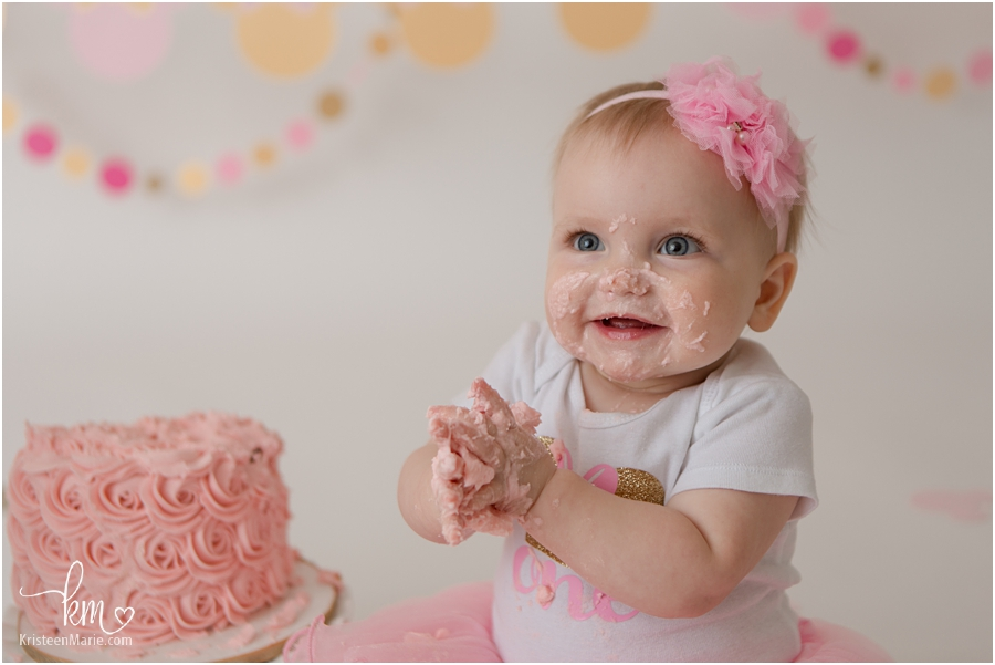 happy baby girl with birthday cake