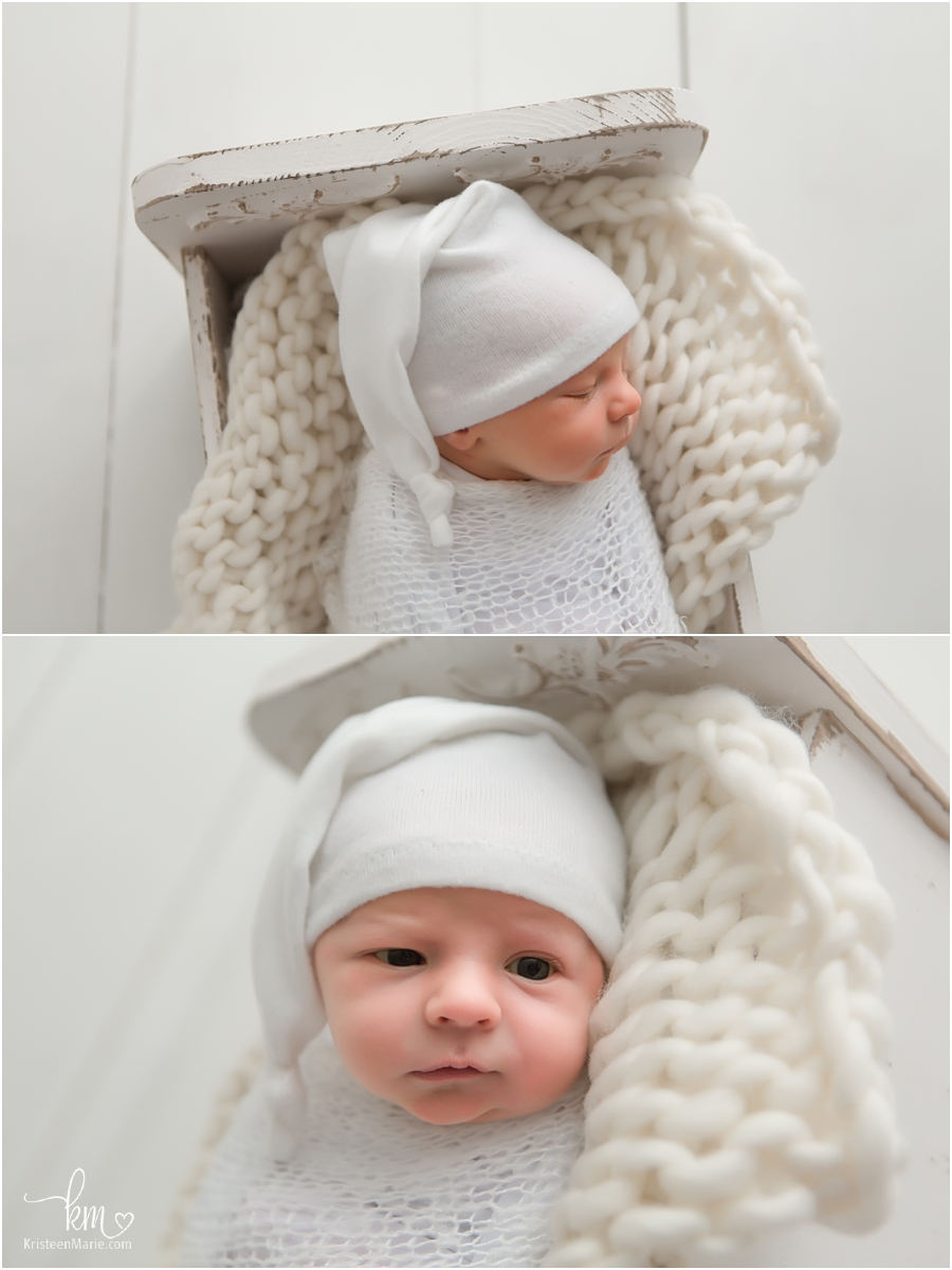 newborn baby boy on white in hat