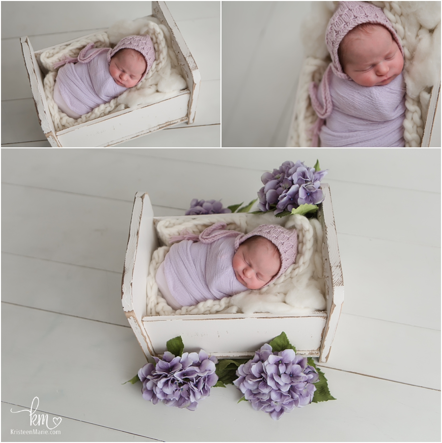 Seeping newborn photography baby in a basket with purple flowers