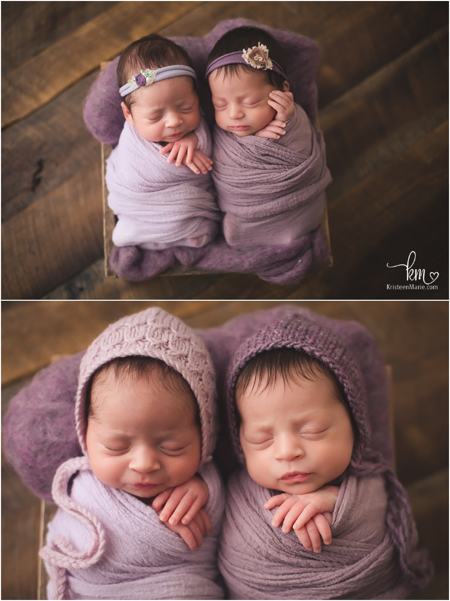 newborn twin girls in purple on rustic backdrop - Indy newborn twin photographer