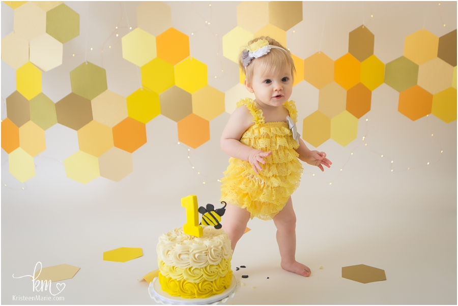 1st birthday cake smash - birthday girl standing