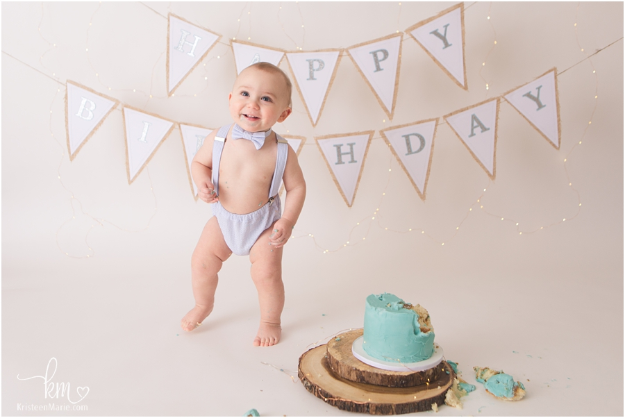 Happy 1st birthday boy at cake smash session - Indianapolis photographer