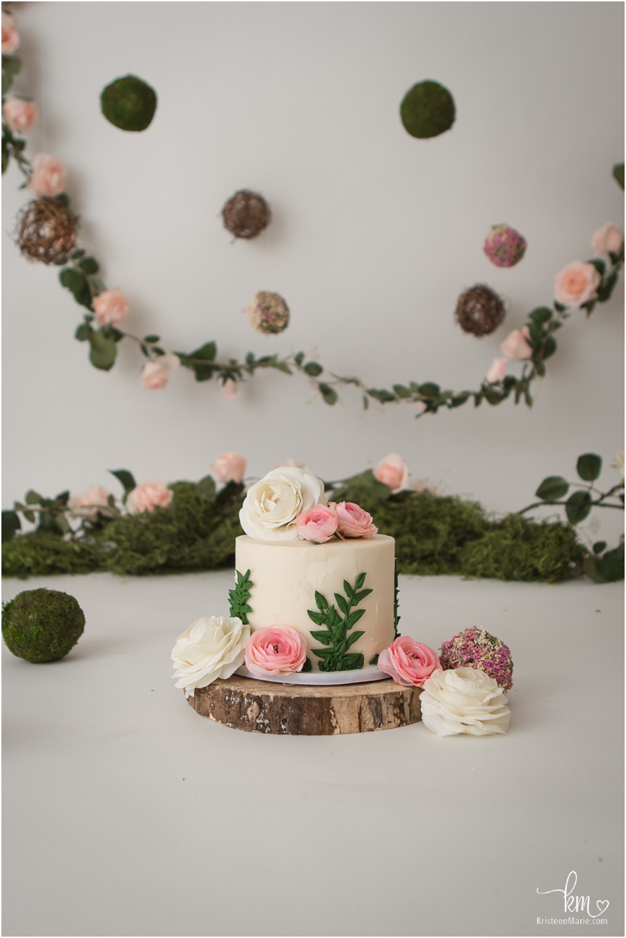 garden themed birthday cake with flowers