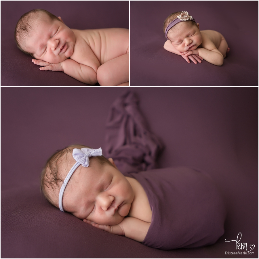 newborn baby girl on purple backdrop