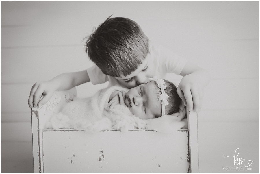 black and white sibling picture - newborn photography