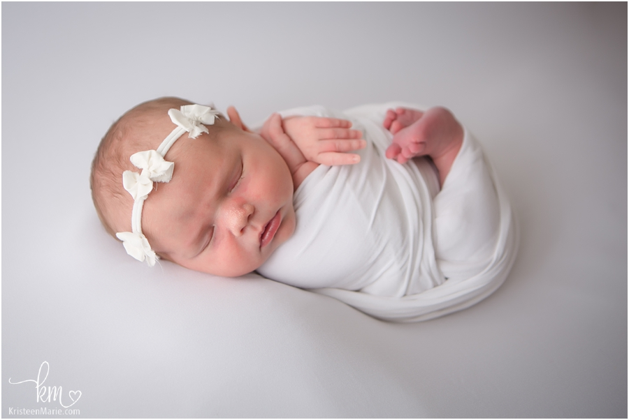 newborn baby girl in white