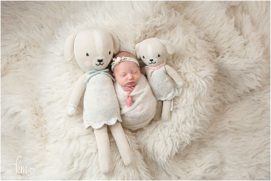 newborn baby with stuffed animals