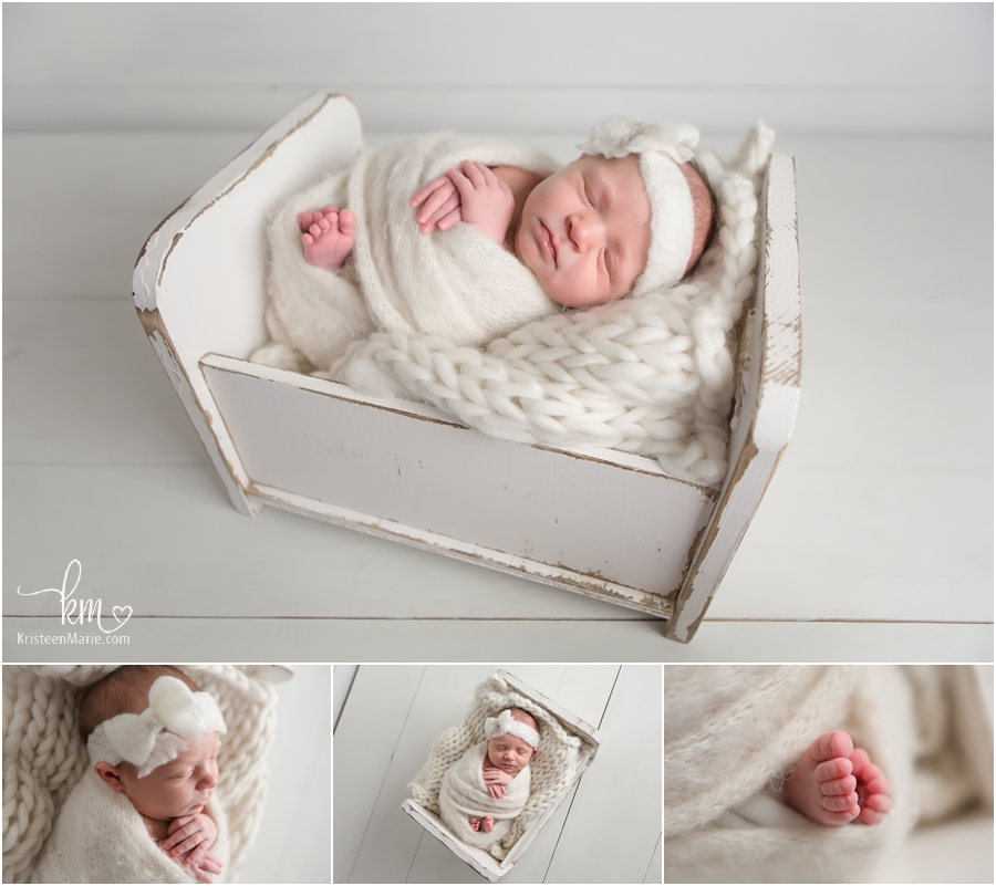 newborn baby girl in cream