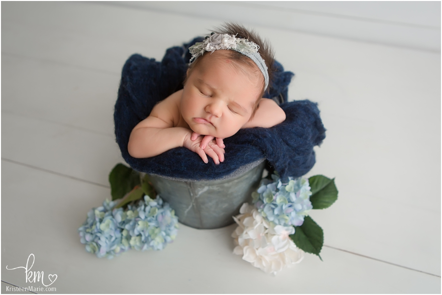 newborn girl in a bucket - blue flowers